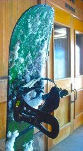 A snowboard rests following use on a sunny May day. Photo by Tim Graves.