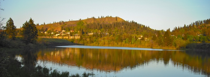 The east end of Mosier is reflected in still waters. Photo by Tim Graves.